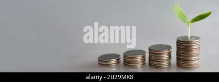 Chart tower with silver metall coin against gray background