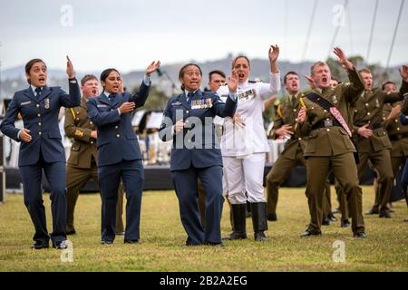 Military personal perform a haka at Navy parade prior to Waitangi Day. New Zealand's national day commemorates the signing of treaty on 6 Feb 1840 - Stock Photo
