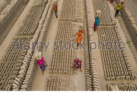 Bangladesh's brick making industry which show them piling up in thousands as manufacturing processes wreak havoc on the surrounding environment. - Stock Photo