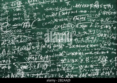 a blackboard full of mathematical formulas. educational concept background - Stock Photo