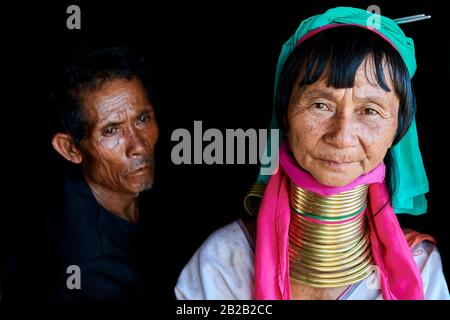 Portrait of a Kayan Lahwi woman with her husband. The Long Neck Kayan (also called Padaung in Burmese) are a sub-group of the Karen ethnic from - Stock Photo
