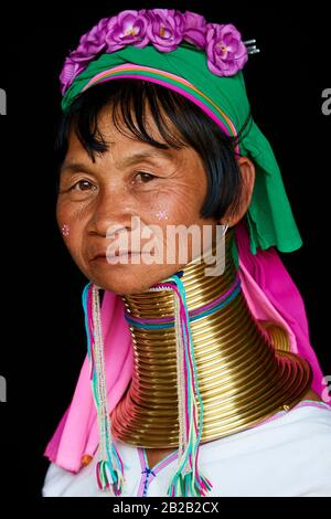 Head portrait of a Kayan Lahwi woman with brass neck coils and traditional clothing. The Long Neck Kayan (also called Padaung in Burmese) are a