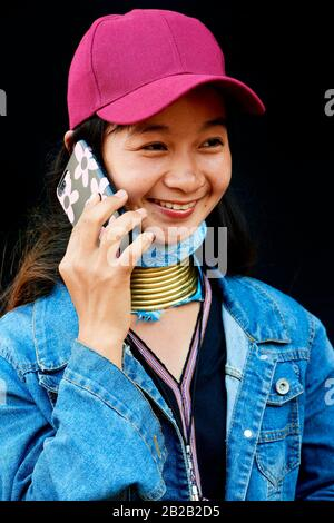Portrait of a young Kayan Lahwi woman wearing false neck rings, which she wears occasionnally. She mixes the traditional Kayan shirt with modern
