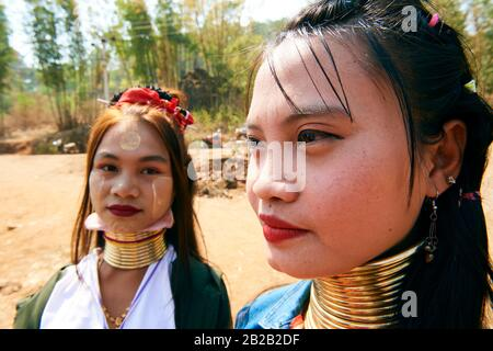 Portrait of 2 young Kayan Lahwi women wearing occasional false neck rings. The Long Neck Kayan (also called Padaung in Burmese) are a sub-group of