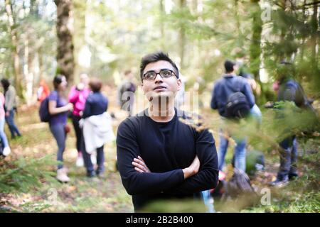 Asian man enjoying the environment in forest. Eibsee, Bavaria, Germany.