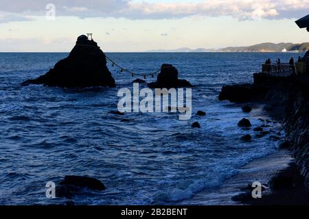 Honshu,Japan,Mie region,Futami, Meoto-Iwa, two rocks considered to be male and female, joined in matrimony by shim. - Stock Photo