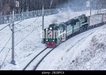 Korolev, Russia - February 23, 2019: Retro train moves at winter day time.