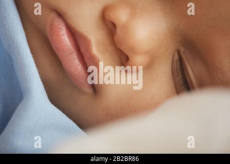 Close up detail view at cute mixed-race baby boy - Stock Photo