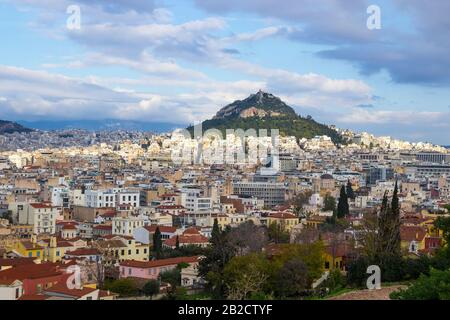 Panoramic skyline view of Athens old town, Greece. Mount Lycabettus on the background. Aerial view from Areopagus rock - Stock Photo