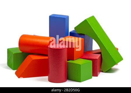 Colorful wooden toy blocks against white background - Stock Photo