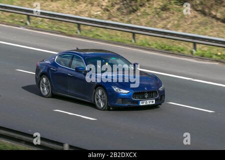 2005 blue Maserati Ghibli DV6 Auto; Vehicular traffic, transport, modern vehicles, saloon cars, vehicle on UK roads, motors on the M6 motorway - Stock Photo