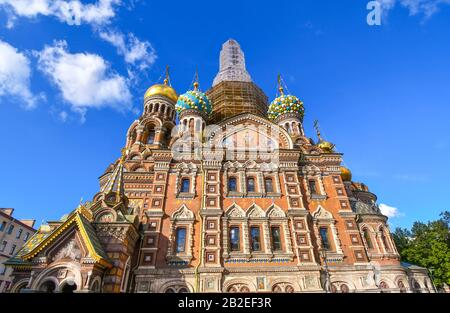 The ornate and colorful rear facade of the Church of our Savior on the Spilled Blood in Saint Petersburg, Russia. - Stock Photo