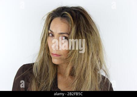 A beautiful Colombian Woman having a messy wild hair day - Stock Photo