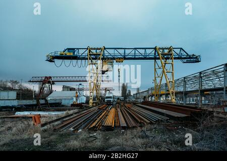 Construction site in old industrial area of metalworking factory. - Stock Photo
