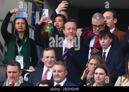 Former Prime Minister of the United Kingdom, David Cameron sings the national anthem ahead of kick off with his son, Elwin (R) - Aston Villa v Manchester City, Carabao Cup Final, Wembley Stadium, London, UK - 1st March 2020  Editorial Use Only - DataCo restrictions apply - Stock Photo