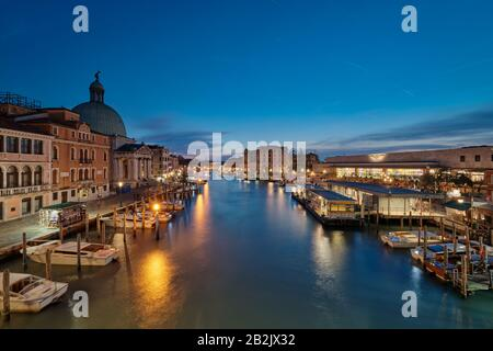 Panoramic sunset view. View of the Grand Canal from the Bridge of the Barefoot (Ponte degli Scalzi).