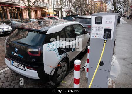 Electric car of Drive Now car sharing company  charging on street in Prenzlauer Berg, Berlin, Germany - Stock Photo