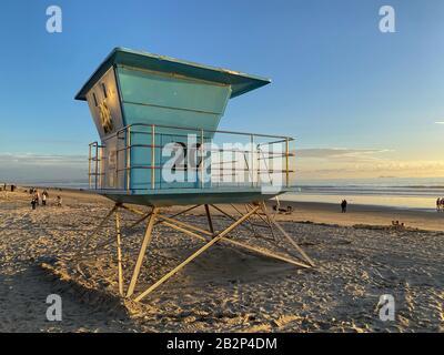 Lifeguard tower on the Coronado Beach during sunset time. San Diego, California, USA. - Stock Photo