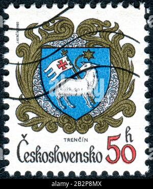 CZECHOSLOVAKIA - CIRCA 1982: A stamp printed in Czechoslovakia, depicts the coat of arms of the city of Trencin, circa 1982 - Stock Photo