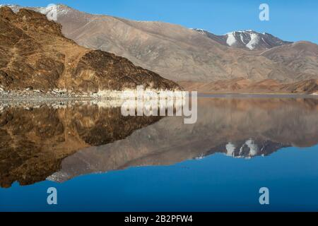 Mirror reflection in calm lake. morning light. Western Mongolia