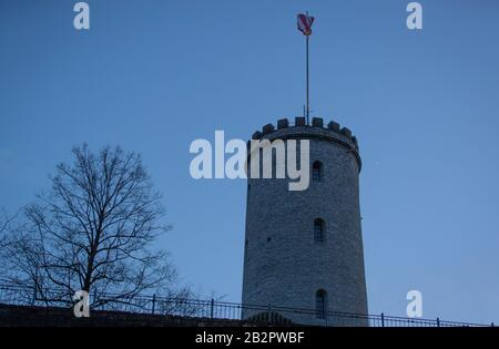Bielefeld, Germany. 03rd Mar, 2020. The tower of the Sparrenburg Castle appears at the blue hour. The building is the landmark of the East Westphalian city. Credit: Friso Gentsch/dpa/Alamy Live News - Stock Photo