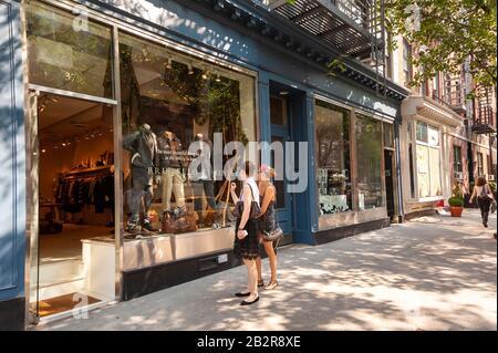 Young women window shopping in Bleecker Street, Greenwich Village, New York City, America, USA - Stock Photo