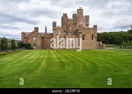 Long shot of Castle of Mey in Caithness, Scotland on a cloudy day