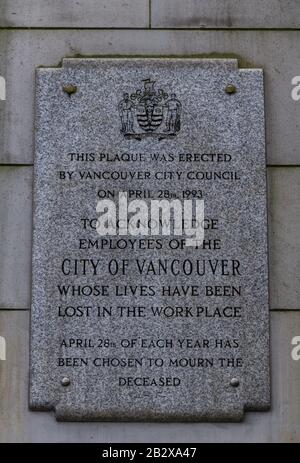 Vancouver, Canada - February 17, 2020: View of Information Board (Plaque) on a Grey wall of Vancouver City Hall Building - Stock Photo