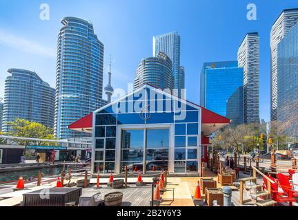 Toronto, Ontario, Canada-10 May, 2019: Famous Toronto Pier6 terminal at Quay Terminal and Yok St, a starting point for Toronto harbor tours and boats - Stock Photo