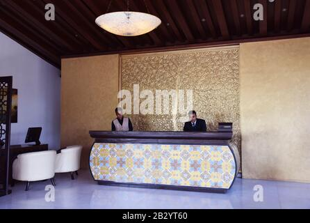 A Hotel reception desk in an Indian Hotel - Stock Photo