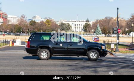 Vice President Mike Pence seen riding in his motorcade on Constitution Avenue, passed the White House in the background. - Stock Photo