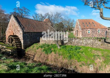 Undershot water wheel at Preston Mill, a historic water mill, on the River Tyne near East Linton in East Lothian, Scotland, United Kingdom Stock Photo