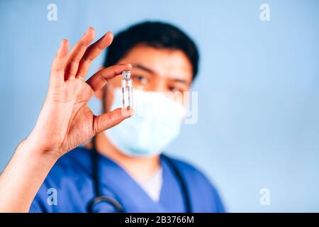 the doctor holds a test tube with medicine - Stock Photo