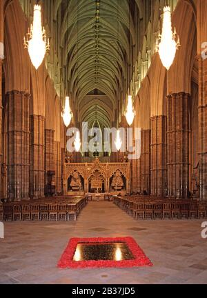 Interior of Westminster Abbey at night the Nave & British Grave or Tomb of The Unknown Warrior honour the unknown dead of First World War London UK - Stock Photo
