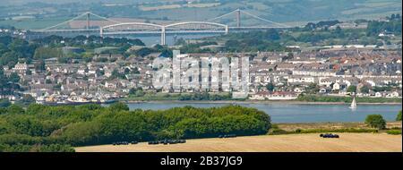 Isambard Kingdom Brunel rail bridge & modern road bridge over River Tamar with Torpoint urban landscape & Cornwall farming countryside  England UK - Stock Photo
