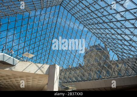 Interior view of the famous glass pyramid of the Louvre museum in Paris, France