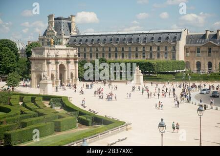 Summer view of the Jardin and Arc de Triomphe du Carrousel next to the Louvre, Paris, France