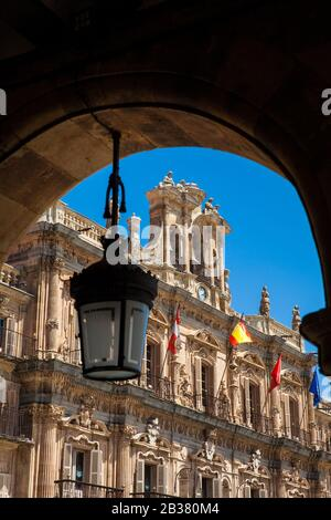 View of the beautiful antique buildings around Plaza Mayor an 18th century Spanish baroque public square surrounded by shops, restaurants and the town - Stock Photo