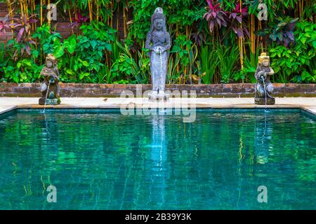 beautiful swimming pool in tropical resort on bright summer day. - Stock Photo