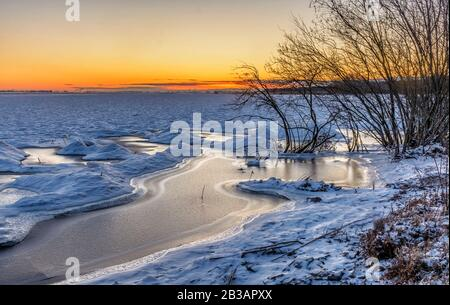 Sunny day February 29, 2020 on the shores of the Gulf of Finland. - Stock Photo