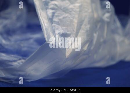 Close up view of transparent polyethylene plastic bag from on a blue background