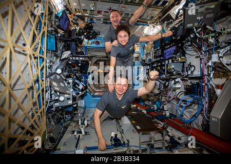 ISS - 20 Feb 2020 - The Expedition 62 crew poses for a playful portrait aboard the International Space Station's U.S. Destiny laboratory module. From - Stock Photo