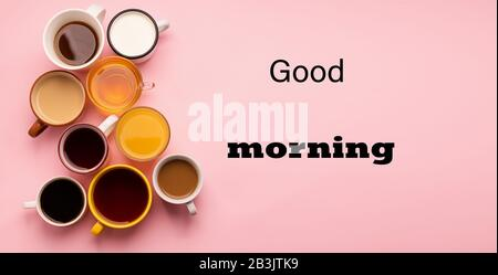 Mugs and glasses with various traditional drinks coffee tea juice juice, text good morning on a pink background. Flat top view. Drinks concept. Copy s - Stock Photo