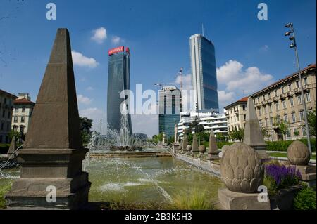 Italy, Lombardy, Milan, Citylife Shopping District. Skyline, on the left Generali Tower Called Lo Storto by arch. Zaha Hadid. Right Allianz Tower Called Il Dritto dell'arch. Harata Ysozaky. In the center Torre Terza Called the Curved by Daniel Liberskind. - Stock Photo