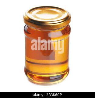 Glass jar with sweet honey isolated on white background - Stock Photo