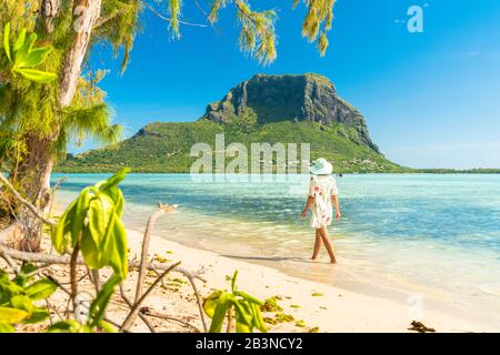 Woman walking on tropical sand beach, Ile aux Benitiers, La Gaulette, Le Morne, Black River, Mauritius, Indian Ocean, Africa