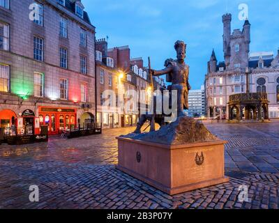 The Gordon Highlanders Statue by sculptor Mark Richards on Castle Street with the Mercat Cross behind in Aberdeen Scotland