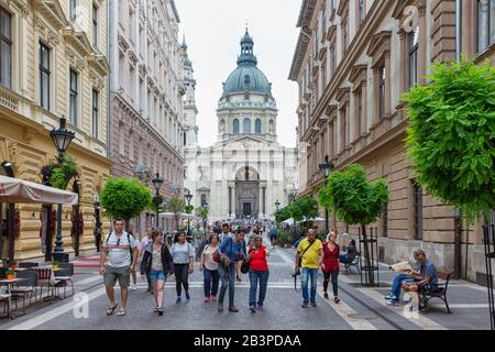 People walking in street in front of St Stephen's Basilica - Stock Photo
