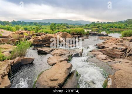 Stream with rocks near Crocodile Bridge in Kruger National Park, South Africa