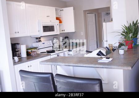 London Canada, March 05 2020: editorial illustrative photo of a kitchen interior showing a spacious loft in Canada. Theme of affordable living. - Stock Photo